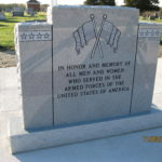 """Veterans monument inscribed with """"In honor and memory of all men and women who served in the armed forces of the United States of America"""""""