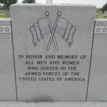 "Veterans monument inscribed with ""In honor and memory of all men and women who served in the armed forces of the United States of America"""